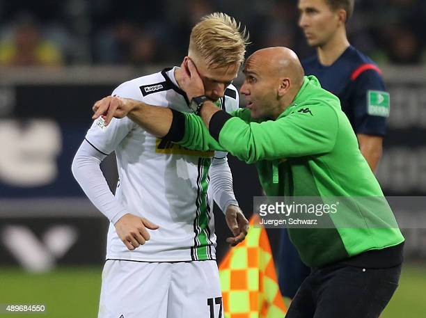 Headcoach Andre Schubert of Moenchengladbach instructs Oscar Wendt during the Bundesliga match between Borussia Moenchengladbach and FC Augsburg at...