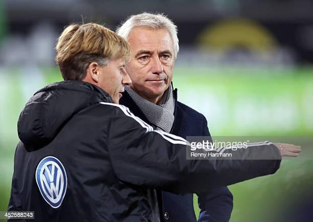 Headcoach Bert van Marwijk of Hamburg and assistant coach Andries Jonker of Wolfsburg chat prior to the Bundesliga match between VfL Wolfsburg and...
