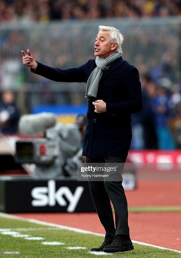Headcoach <a gi-track='captionPersonalityLinkClicked' href=/galleries/search?phrase=Bert+van+Marwijk&family=editorial&specificpeople=649210 ng-click='$event.stopPropagation()'>Bert van Marwijk</a> of Hamburg gestures during the Bundesliga match between Eintracht Braunschweig and Hamburger SV at Eintracht Stadion on February 15, 2014 in Braunschweig, Germany.