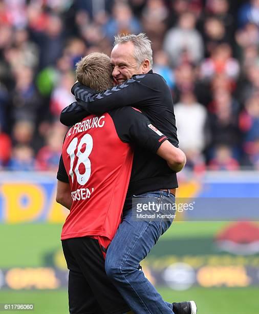Headcoach Christian Streich and Nils Petersen of Freiburg celebrate after the Bundesliga match between Sport Club Freiburg and Eintracht Frankfurt at...