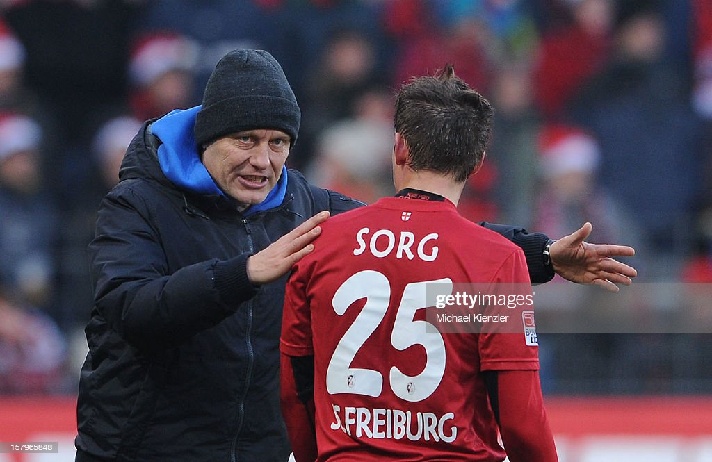 Headcoach <a gi-track='captionPersonalityLinkClicked' href=/galleries/search?phrase=Christian+Streich&family=editorial&specificpeople=4411796 ng-click='$event.stopPropagation()'>Christian Streich</a> (L) Freiburg is talking with Oliver Sorg during the Bundesliga match between SC Freiburg and SpVgg Greuther Fuerth at Mage Solar Stadium on December 8, 2012 in Freiburg, Germany.