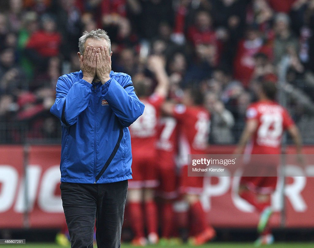 Headcoach <a gi-track='captionPersonalityLinkClicked' href=/galleries/search?phrase=Christian+Streich&family=editorial&specificpeople=4411796 ng-click='$event.stopPropagation()'>Christian Streich</a> of Freiburg reacts after 3rd goal for his team during the Bundesliga match between SC Freiburg and Borussia Moenchengladbach at Mage Solar Stadium on April 19, 2014 in Freiburg, Germany.