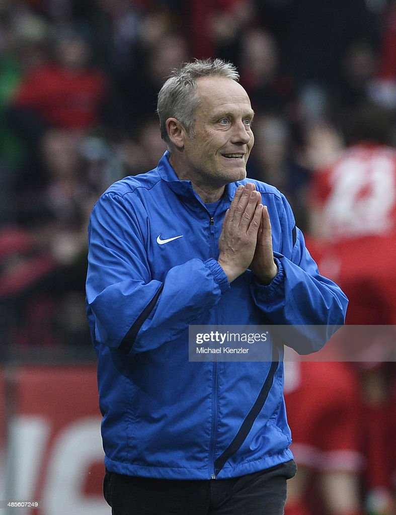 Headcoach <a gi-track='captionPersonalityLinkClicked' href=/galleries/search?phrase=Christian+Streich&family=editorial&specificpeople=4411796 ng-click='$event.stopPropagation()'>Christian Streich</a> of Freiburg reacts after 3rd goal for Freiburg during the Bundesliga match between SC Freiburg and Borussia Moenchengladbach at Mage Solar Stadium on April 19, 2014 in Freiburg, Germany.