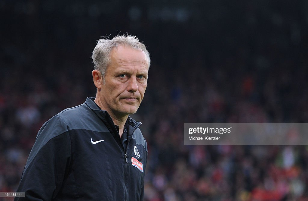 Headcoach <a gi-track='captionPersonalityLinkClicked' href=/galleries/search?phrase=Christian+Streich&family=editorial&specificpeople=4411796 ng-click='$event.stopPropagation()'>Christian Streich</a> of Freiburg reacts before the Bundesliga match between SC Freiburg and Borussia Moenchengladbach at Mage Solar Stadium on August 31, 2014 in Freiburg, Germany.
