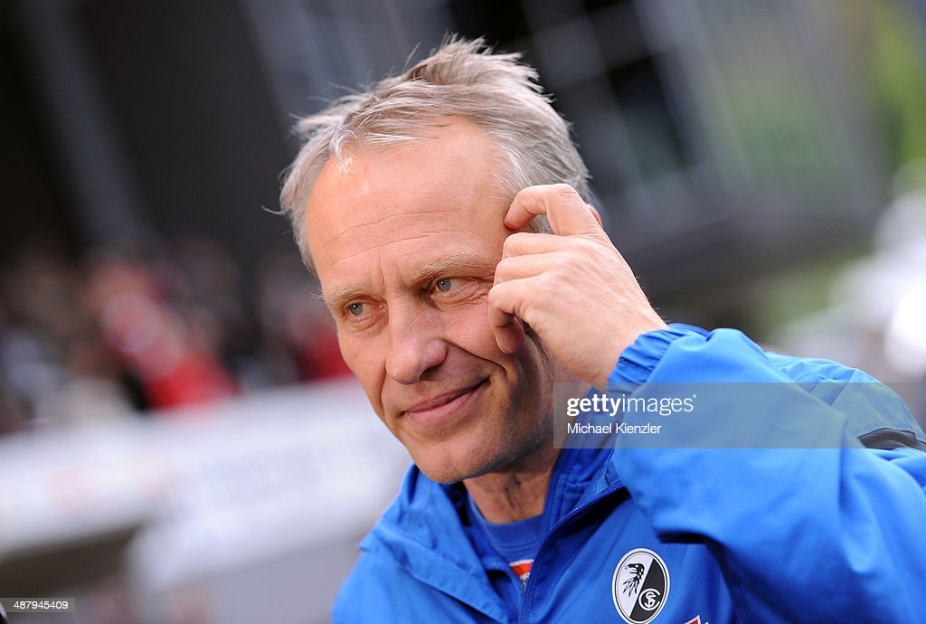 Headcoach <a gi-track='captionPersonalityLinkClicked' href=/galleries/search?phrase=Christian+Streich&family=editorial&specificpeople=4411796 ng-click='$event.stopPropagation()'>Christian Streich</a> of Freiburg reacts before the Bundesliga match between SC Freiburg and FC Schalke 04 at Mage Solar Stadium on May 3, 2014 in Freiburg, Germany.