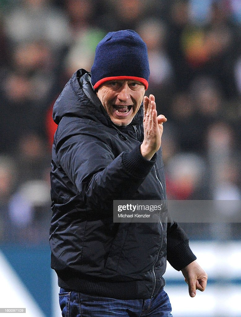 Headcoach <a gi-track='captionPersonalityLinkClicked' href=/galleries/search?phrase=Christian+Streich&family=editorial&specificpeople=4411796 ng-click='$event.stopPropagation()'>Christian Streich</a> of Freiburg reacts during the Bundesliga match between SC Freiburg and Bayer 04 Leverkusen at MAGE SOLAR Stadium on January 26, 2013 in Freiburg, Germany.