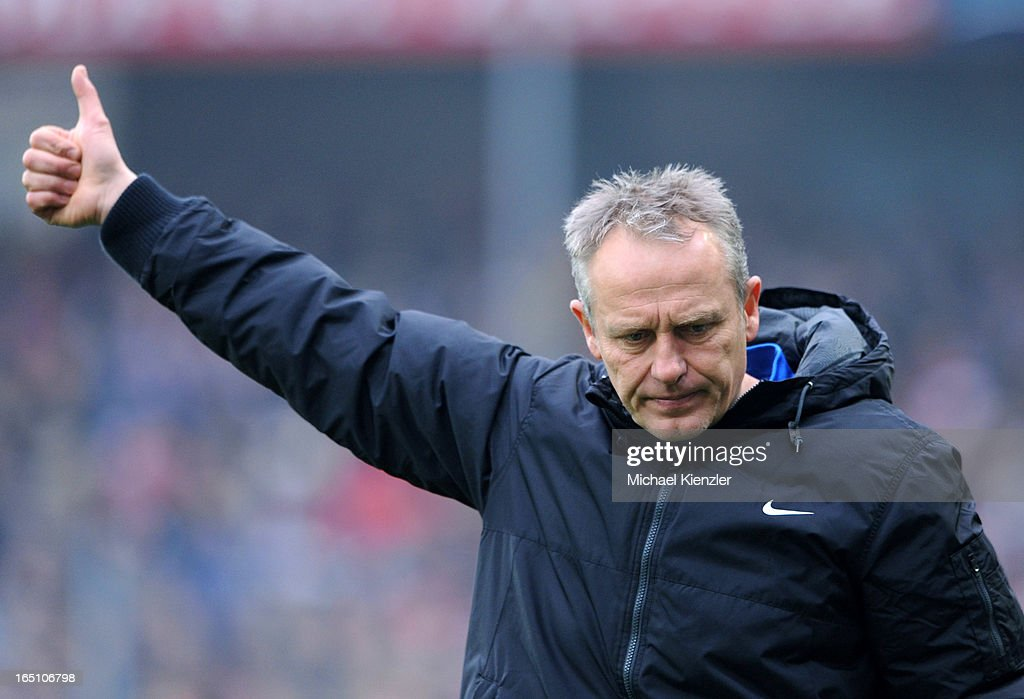 Headcoach Christian Streich of Freiburg reacts during the Bundesliga match between SC Freiburg and VfL Borussia Moenchengladbach at MAGE SOLAR Stadium on March 30, 2013 in Freiburg, Germany.