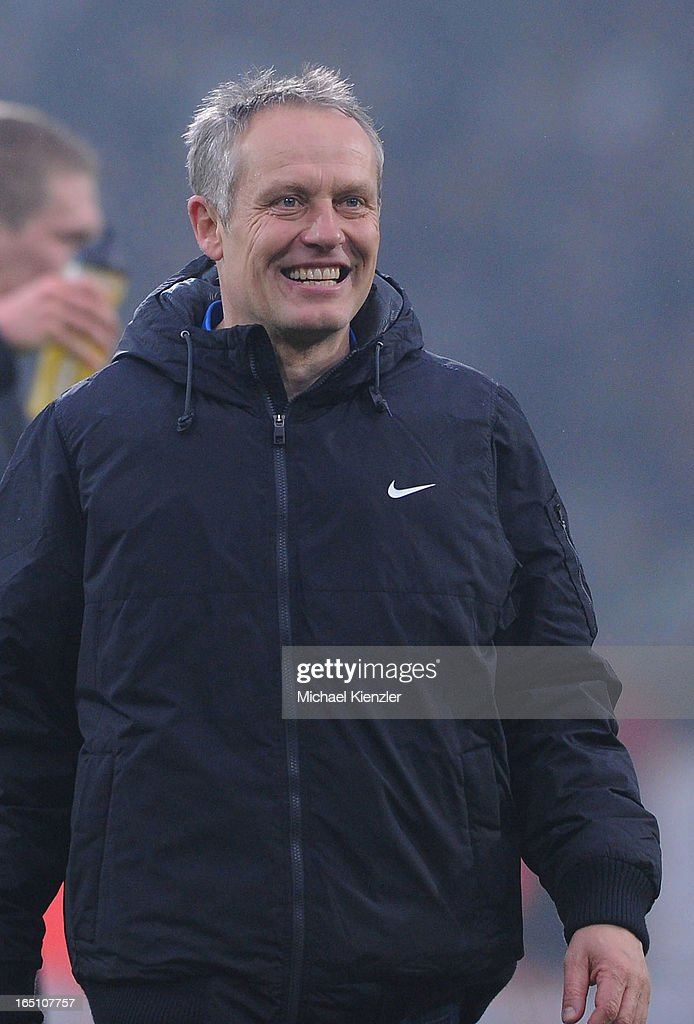 Headcoach Christian Streich of Freiburg smiles after the Bundesliga match between SC Freiburg and VfL Borussia Moenchengladbach at MAGE SOLAR Stadium on March 30, 2013 in Freiburg, Germany.