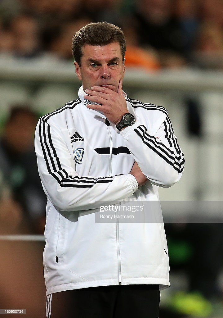 Headcoach <a gi-track='captionPersonalityLinkClicked' href=/galleries/search?phrase=Dieter+Hecking&family=editorial&specificpeople=535775 ng-click='$event.stopPropagation()'>Dieter Hecking</a> of Wolfsburg looks on during the Bundesliga match between VfL Wolfsburg and Werder Bremen at Volkswagen Arena on October 26, 2013 in Wolfsburg, Germany.