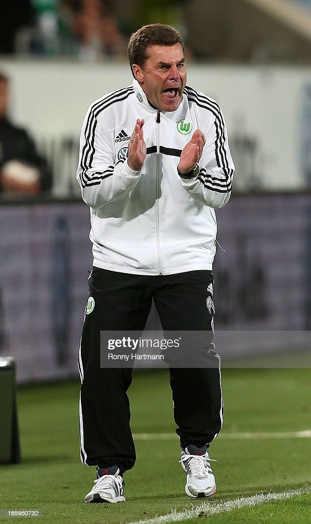 Headcoach <a gi-track='captionPersonalityLinkClicked' href=/galleries/search?phrase=Dieter+Hecking&family=editorial&specificpeople=535775 ng-click='$event.stopPropagation()'>Dieter Hecking</a> of Wolfsburg reacts during the Bundesliga match between VfL Wolfsburg and Werder Bremen at Volkswagen Arena on October 26, 2013 in Wolfsburg, Germany.
