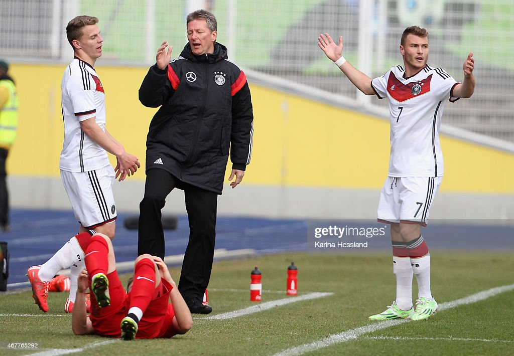 Headcoach Frank Wormuth and Maximilian Dittgen of Germany react during the International Friendly match between U20 Germany and U20 Poland at...