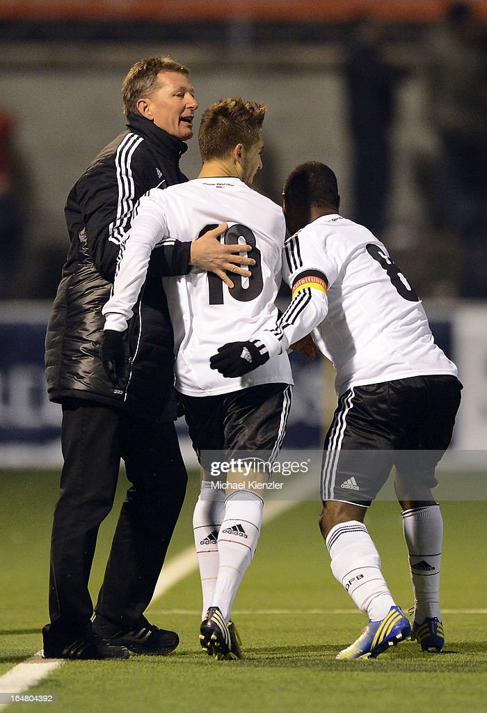 Headcoach <a gi-track='captionPersonalityLinkClicked' href=/galleries/search?phrase=Frank+Wormuth&family=editorial&specificpeople=2515350 ng-click='$event.stopPropagation()'>Frank Wormuth</a> (R) celebrates with goalscorer <a gi-track='captionPersonalityLinkClicked' href=/galleries/search?phrase=Moritz+Leitner&family=editorial&specificpeople=7118695 ng-click='$event.stopPropagation()'>Moritz Leitner</a> (no. 10) and <a gi-track='captionPersonalityLinkClicked' href=/galleries/search?phrase=Reinhold+Yabo&family=editorial&specificpeople=4251446 ng-click='$event.stopPropagation()'>Reinhold Yabo</a> during the international friendly match between U20 Switzerland and U20 Germany at Eps Stadium on March 26, 2013 in Baden, Switzerland