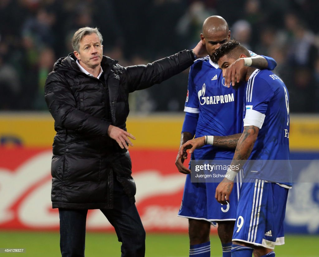 Headcoach Jens Keller of Schalke (L) hugs Felipe Santana (C) beside Kevin-Prince Boateng after the Bundesliga match between Borussia Moenchengladbach and FC Schalke 04 at Borussia-Park on December 7, 2013 in Moenchengladbach, Germany.