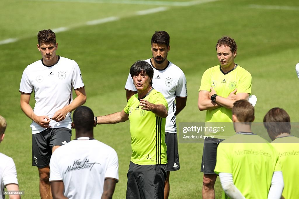 Head-Coach Joachim Loew (C) and Mario Gomez (L) of German National Football Team attend a training session at Lago Maggiore in Ascona, Switzerland on May 26, 2016. Germany's national soccer team prepares for the upcoming UEFA EURO 2016, to be held in France, in a training camp in Ascona.
