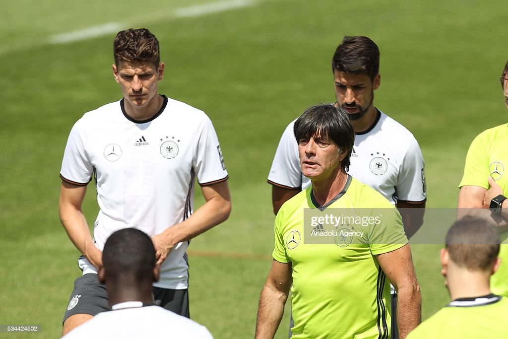 Head-Coach Joachim Loew (R), Mario Gomez (L) and Sami Khedira (rear) of German National Football Team attend a training session at Lago Maggiore in Ascona, Switzerland on May 26, 2016. Germany's national soccer team prepares for the upcoming UEFA EURO 2016, to be held in France, in a training camp in Ascona.