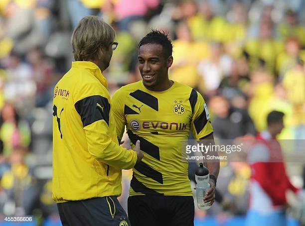 Headcoach Juergen Klopp of Dortmund hugs PierreEmerick Aubameyang after the Bundesliga match between Borussia Dortmund and SC Freiburg at Signal...