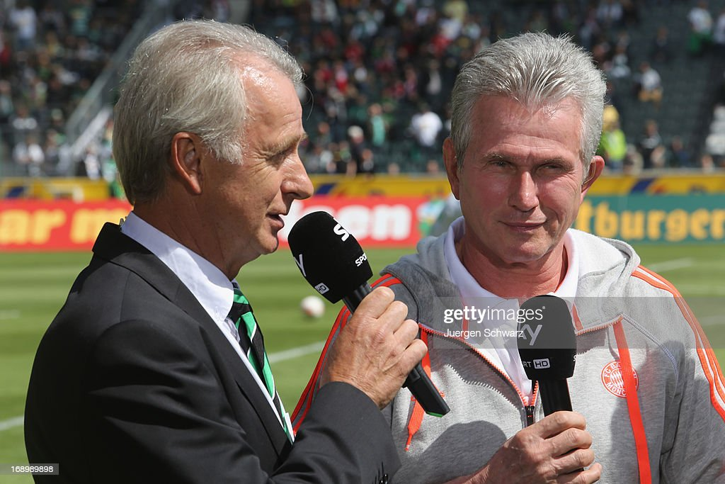 Headcoach <a gi-track='captionPersonalityLinkClicked' href=/galleries/search?phrase=Jupp+Heynckes&family=editorial&specificpeople=2062040 ng-click='$event.stopPropagation()'>Jupp Heynckes</a> (R) of Munich stands beside Rainer Bonhoff at the Bundesliga match between Borussia Moenchengladbach and Bayern Muenchen at Borussia Park Stadium on May 18, 2013 in Moenchengladbach, Germany.