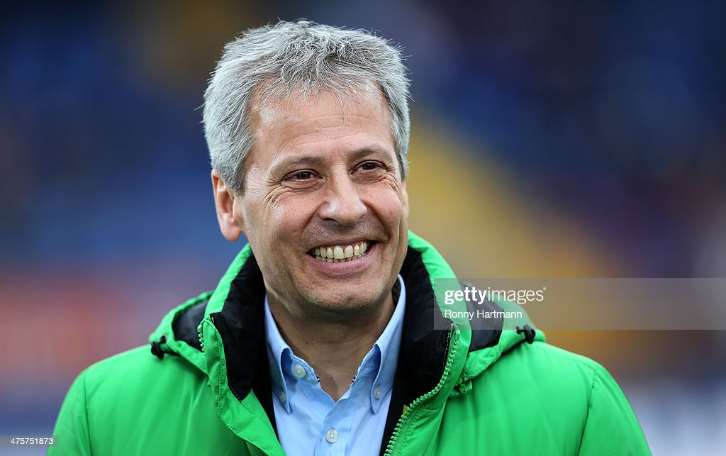 Headcoach <a gi-track='captionPersonalityLinkClicked' href=/galleries/search?phrase=Lucien+Favre&family=editorial&specificpeople=4313368 ng-click='$event.stopPropagation()'>Lucien Favre</a> of Moenchengladbach smiles prior to the Bundesliga match between Eintracht Braunschweig and Borussia Moenchengladbach at Eintracht Stadion on March 1, 2014 in Braunschweig, Germany.