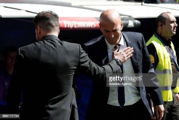 Headcoach of Real Madrid Zinedine Zidane and Headcoach of Atletico Madrid Diego Simeone wish for success before the La Liga football match between...