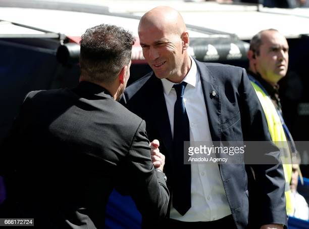 Headcoach of Real Madrid Zinedine Zidane shakes hands with Headcoach of Atletico Madrid Diego Simeone before the La Liga football match between Real...