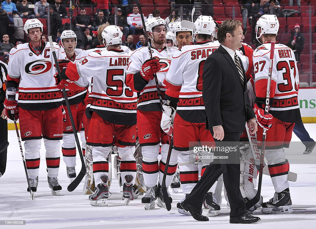 Headcoach of the Carolina Hurricanes Kirk Muller crosses the ice as the players celebrate his first victory in his former city after the NHL game against the Montreal Canadiens on February 13, 2012 at the Bell Centre in Montreal, Quebec, Canada.