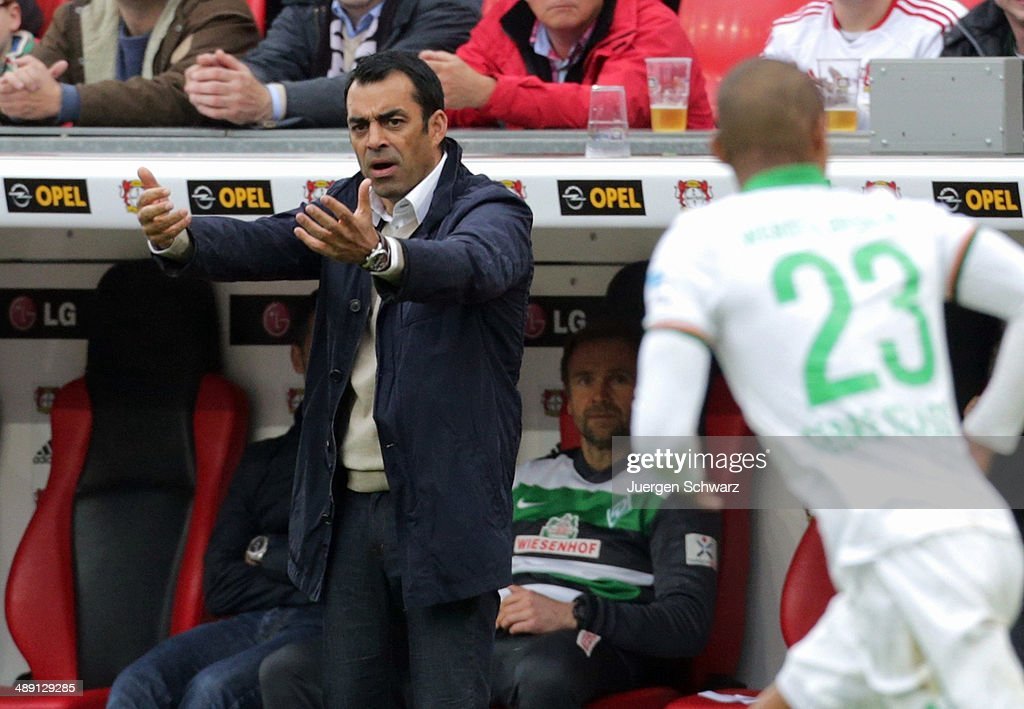 Headcoach <a gi-track='captionPersonalityLinkClicked' href=/galleries/search?phrase=Robin+Dutt&family=editorial&specificpeople=3175490 ng-click='$event.stopPropagation()'>Robin Dutt</a> of Bremen gives instructions during the Bundesliga match between Bayer 04 Leverkusen and Werder Bremen at BayArena on May 10, 2014 in Leverkusen, Germany.