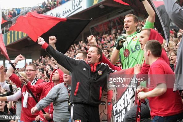 Headcoach Sascha Lewandowski of Leverkusen and goalkeeper Bernd Leno celebrate with supporters after the Bundesliga match between Bayer 04 Leverkusen...