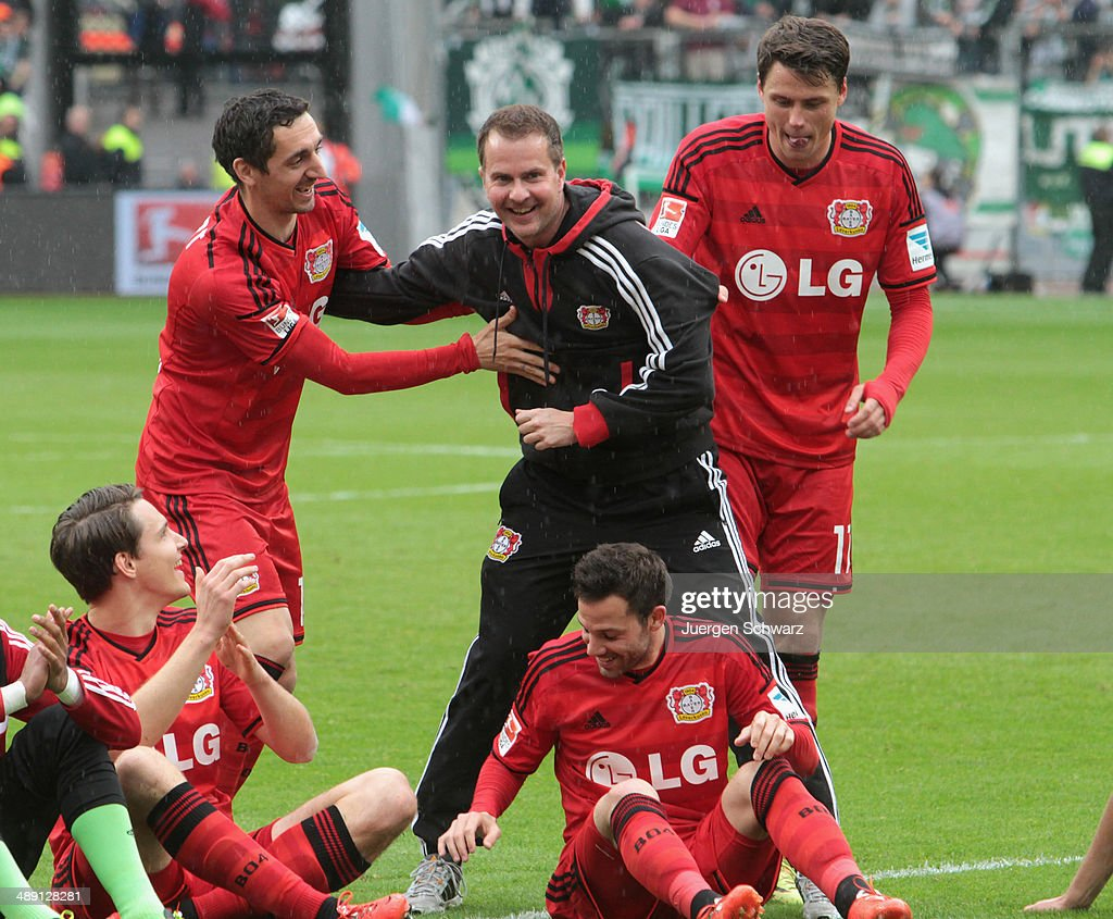 Headcoach <a gi-track='captionPersonalityLinkClicked' href=/galleries/search?phrase=Sascha+Lewandowski&family=editorial&specificpeople=5134760 ng-click='$event.stopPropagation()'>Sascha Lewandowski</a> of Leverkusen (C) celebrates with <a gi-track='captionPersonalityLinkClicked' href=/galleries/search?phrase=Roberto+Hilbert&family=editorial&specificpeople=620757 ng-click='$event.stopPropagation()'>Roberto Hilbert</a> (L) and <a gi-track='captionPersonalityLinkClicked' href=/galleries/search?phrase=Sebastian+Boenisch&family=editorial&specificpeople=632472 ng-click='$event.stopPropagation()'>Sebastian Boenisch</a> after the Bundesliga match between Bayer 04 Leverkusen and Werder Bremen at BayArena on May 10, 2014 in Leverkusen, Germany.