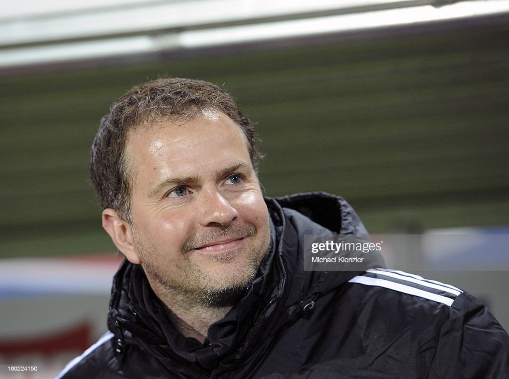 Headcoach <a gi-track='captionPersonalityLinkClicked' href=/galleries/search?phrase=Sascha+Lewandowski&family=editorial&specificpeople=5134760 ng-click='$event.stopPropagation()'>Sascha Lewandowski</a> of Leverkusen smiles before the Bundesliga match between SC Freiburg and Bayer 04 Leverkusen at MAGE SOLAR Stadium on January 26, 2013 in Freiburg, Germany.