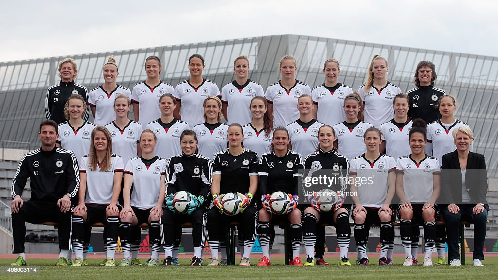 Headcoach Silivia Neid, Anja Mittag, Lena Lotzen, Dzsenifer Marozsan, Jennifer Cramer, Tabea Kemme, Anna Blaesse, Margarita Gidion, Ulrike Ballweg, (middle, L-R) Josephine Henning, Simone Laudehr, Annike Krahn, Saskia Bartusiak, Sara Daebritz, Alexandra Popp, Melanie Leupolz, Verena Faisst, Babett Peter, (front, L-R) assistent coach Michael Fuchs, Lena Petermann, Melanie Behringer, Lisa Weiss, Almuth Schult, Nadine Angerer, Laura Benkharth, Bianca Schmidt, Celia Sasic and team manager Doris Fitschen pose during the team presentation of the German Women's national team at Adi Dassler Stadium on April 4, 2015 in Herzogenaurach, Germany.