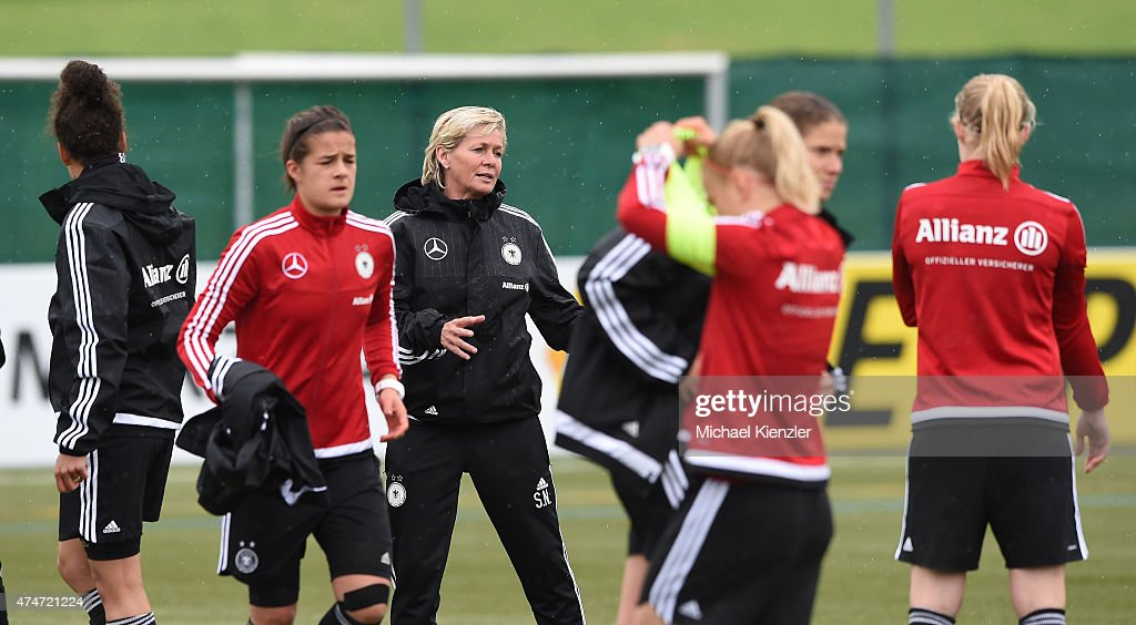 Headcoach Silvia Neid talks to her players during the German National Women's team training on May 25, 2015 in Wollerau, Switzerland.