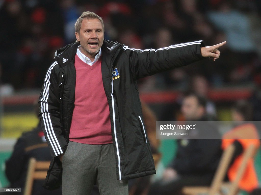 Headcoach <a gi-track='captionPersonalityLinkClicked' href=/galleries/search?phrase=Thorsten+Fink&family=editorial&specificpeople=2381735 ng-click='$event.stopPropagation()'>Thorsten Fink</a> of Hamburg gestures during the Bundesliga match between Bayer Leverkusen and Hamburger SV at BayArena on December 15, 2012 in Leverkusen, Germany.