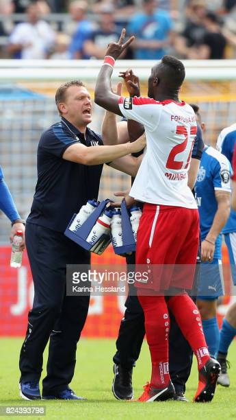 Headcoach Uwe Koschinat in discussion with Cedric Mimbala of Köln during the 3Liga match between FC Carl Zeiss Jena and SC Fortuna Köln at...