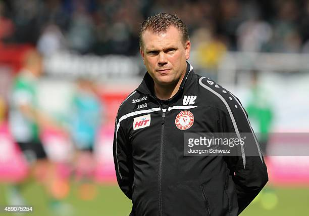 Headcoach Uwe Koschinat of Cologne watches his team warming up for the third league match between Preussen Muenster and Fortuna Koeln at...