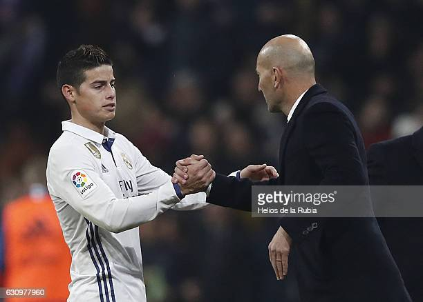 Headcoach Zinedine ZIdane and James Rodriguez of Real Madrid celebrate after scoring during the Copa del Rey round of 16 first leg match between Real...