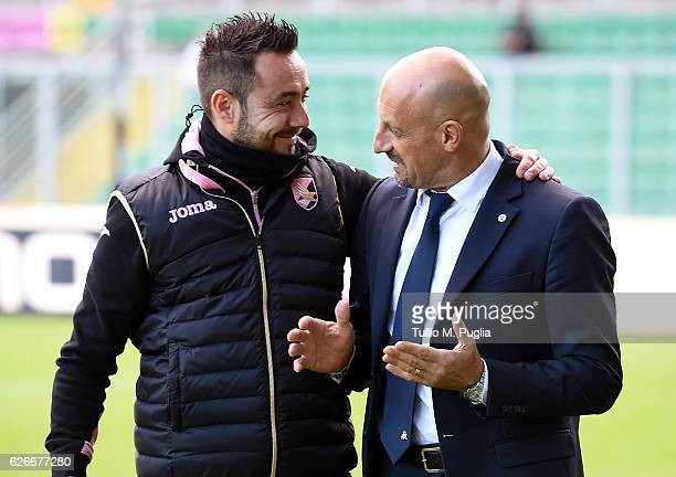 Headcoache Domenico Di Carlo of Spezia speaks with Head Coach Roberto De Zerbi of Palermo during the TIM Cup A match betweenUS Citta di Palermo and...