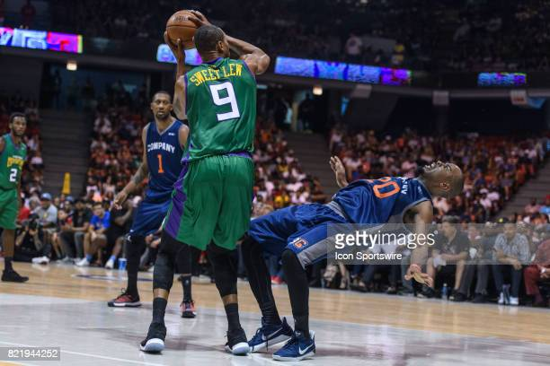 Headed Monsters captain Rashard Lewis attempts a shot as 3's Company Andre Owens falls backwards during a BIG3 Basketball game on July 23 at the UIC...