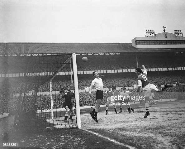A header by Arsenal centreforward Len Julians rebounds off the crossbar as Tottenham Hotspur rightback Peter Baker tries to intercept with Spurs...
