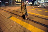 Heading home Denver Athletics Club CEO General Manager Andre van Hall crosses the light rail tracks at the Convention Center station in Denver CO...