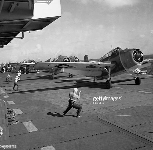 Heading off to a mission over Tinian Grumman TBF Avengers take off from the flight deck of the USS Monterey June 1944