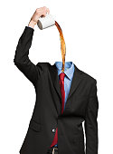 Headless businessman pouring coffee in his shirt