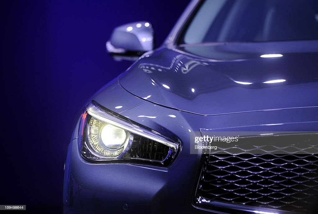 A headlight on the Nissan Motor Co. Infiniti Q50 sedan is seen after being unveiled during the 2013 North American International Auto Show (NAIAS) in Detroit, Michigan, U.S., on Monday, Jan. 14, 2013. Nissan Motor Co.'s Infiniti, lagging larger German, Japanese and U.S. luxury brands, is replacing the G sedan with the Q50 sports car as the company links growth goals for its rechristened lineup to better looks and technology. Photographer: Daniel Acker/Bloomberg via Getty Images