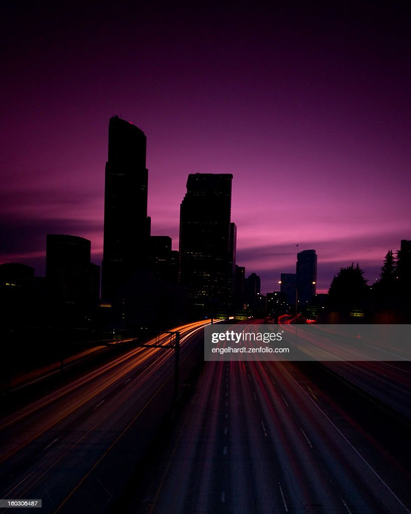 Headlight streaks in city twilight : Stock Photo