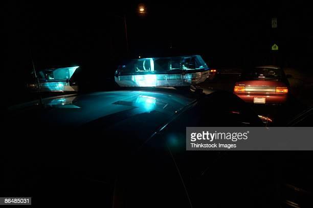 Headlights on police car at night