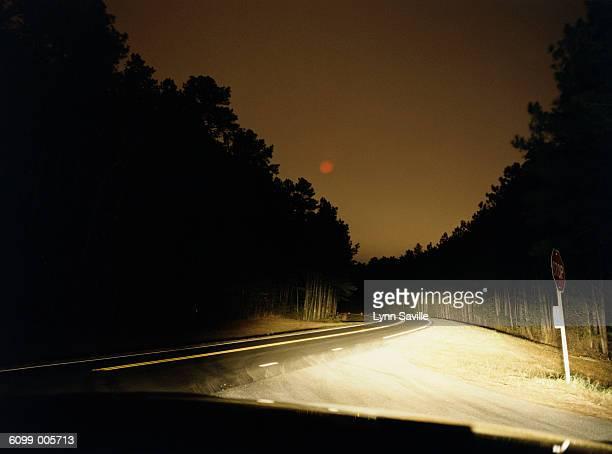 Headlights on Road at Night