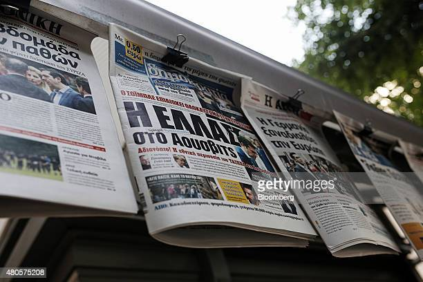 A headline reading 'Greece is Auschwitz' center sits on a newspaper front page hanging outside a magazine kiosk in Thessaloniki Greece on Monday July...