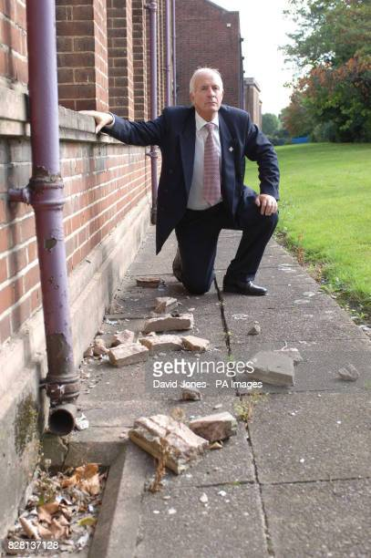 Headmaster Keith Whittlestone Wednesday 21 September 2005 with some fallen masonry at the front of his school after some of his pupils made a DVD...
