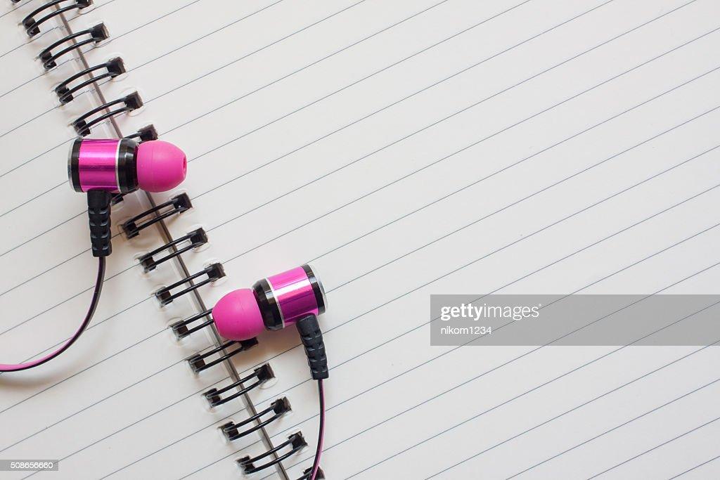 Headphones and notebook : Stock Photo