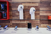 Headphones and smartphones are displayed for sale inside an ATT Inc store in New York US on Friday July 22 2016 ATT posted secondquarter profit that...