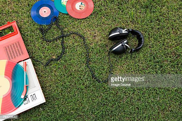 Headphones and turntable on grass